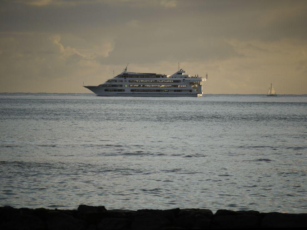Crusing boat at dusk